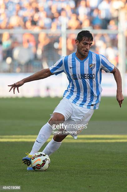 Roque Santa Cruz of Malaga CF runs whit the ball during the La Liga match between Malaga CF and Athletic Club Bilbao at La Rosaleda Stadium on August...