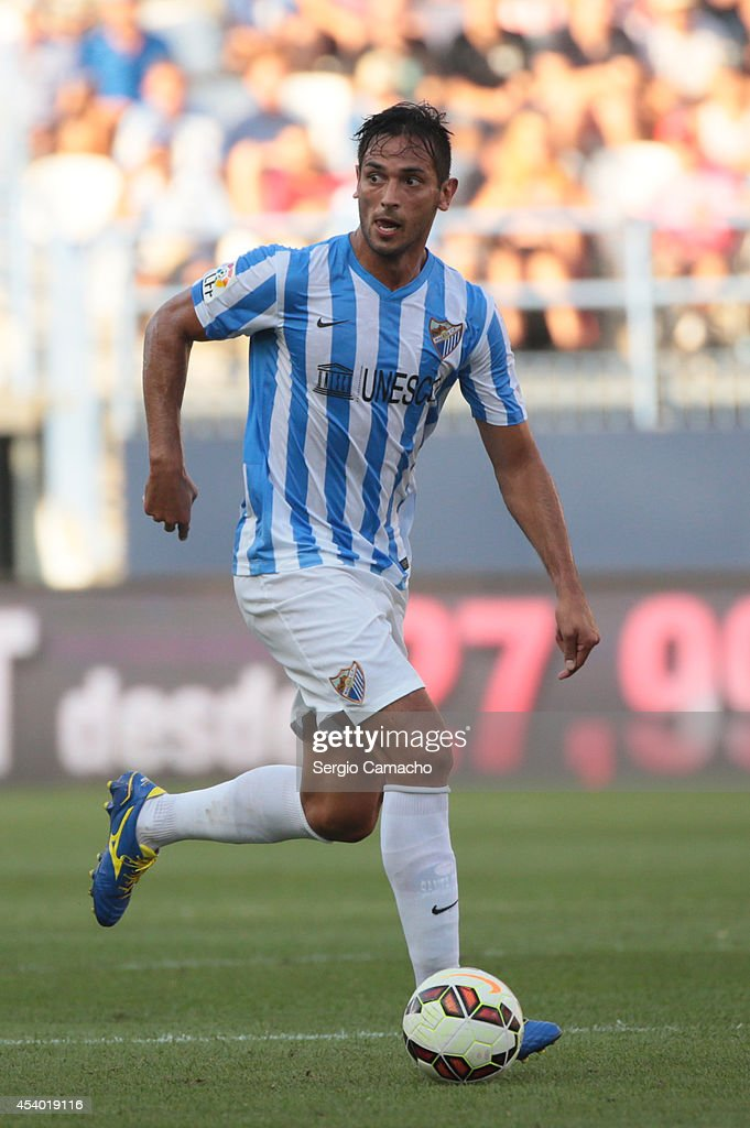 Ê Roque Santa Cruz of Malaga CF runs whit the ball during the La Liga match between Malaga CF and Athletic Club Bilbao at La Rosaleda Stadium on August 23, 2014 in Malaga, Spain.Ê