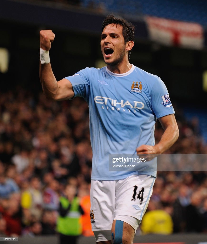 <a gi-track='captionPersonalityLinkClicked' href=/galleries/search?phrase=Roque+Santa+Cruz&family=editorial&specificpeople=224915 ng-click='$event.stopPropagation()'>Roque Santa Cruz</a> of Manchester City celebrates scoring to make it 2-1 during the Carling Cup 4th Round match at the City of Manchester Stadium on October 28, 2009 in Manchester, England.