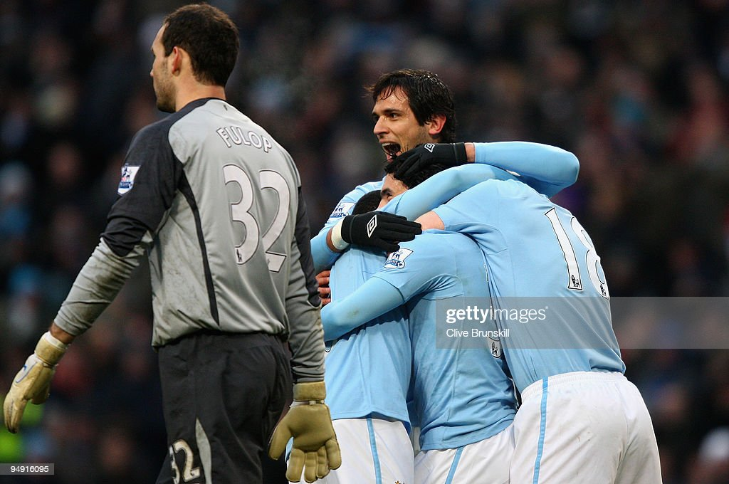 <a gi-track='captionPersonalityLinkClicked' href=/galleries/search?phrase=Roque+Santa+Cruz&family=editorial&specificpeople=224915 ng-click='$event.stopPropagation()'>Roque Santa Cruz</a> (top) of Manchester City celebrates with <a gi-track='captionPersonalityLinkClicked' href=/galleries/search?phrase=Carlos+Tevez&family=editorial&specificpeople=220555 ng-click='$event.stopPropagation()'>Carlos Tevez</a> (2nd R) and teammates after Tevez scored the 2:0 goal from the penalty spot past Sunderland's goalkeeper Martin Fulop during the Barclays Premier League match between Manchester City and Sunderland at the City of Manchester Stadium on December 19, 2009 in Manchester, England.