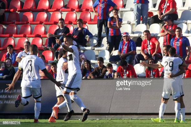 Roque Santa Cruz of Olimpia celebrates with teammates Rodrigo Burgos Richard Ortiz and Hernan Pellerano after scoring the second goal of his team...