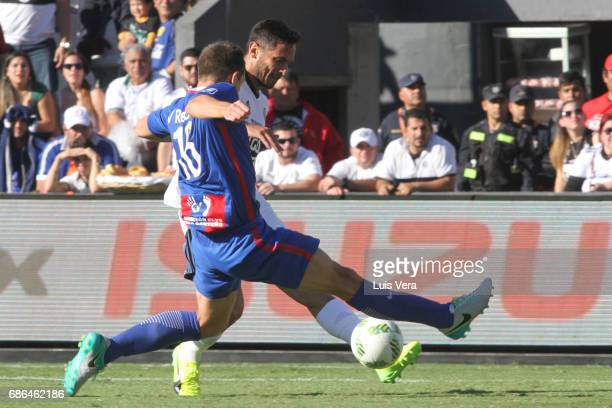 Roque Santa Cruz of Olimpia fights for the ball with Santiago Molina of Cerro Porteño during a match between Olimpia and Cerro Porteño as part of the...