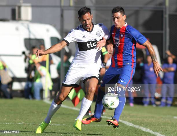 Roque Santa Cruz of Olimpia fights for the ball with William Candia of Cerro Porteño during a match between Olimpia and Cerro Porteño as part of the...