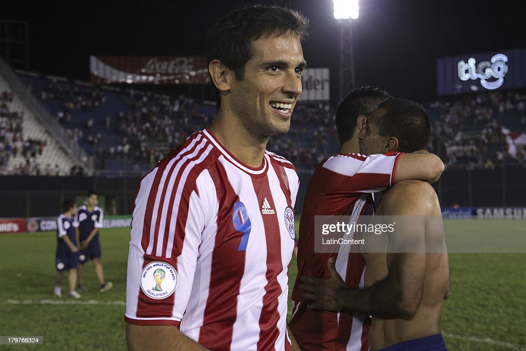 <a gi-track='captionPersonalityLinkClicked' href=/galleries/search?phrase=Roque+Santa+Cruz&family=editorial&specificpeople=224915 ng-click='$event.stopPropagation()'>Roque Santa Cruz</a> (L) of Paraguay celebrates after a match between Paraguay and Bolivia as part of the 15th round of the South American Qualifiers at Defensores del Chaco Stadium on September 06, 2013 in Asuncion, Paraguay.