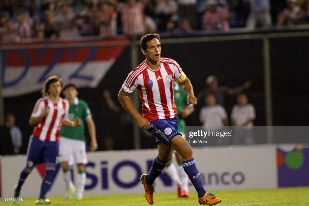 <a gi-track='captionPersonalityLinkClicked' href=/galleries/search?phrase=Roque+Santa+Cruz&family=editorial&specificpeople=224915 ng-click='$event.stopPropagation()'>Roque Santa Cruz</a> of Paraguay celebrates the second goal during a match between Paraguay and Bolivia as part of the 15th round of the South American Qualifiers at Defensores del Chaco Stadium on September 06, 2013 in Asuncion, Paraguay.