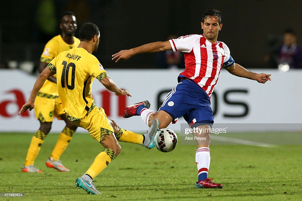 <a gi-track='captionPersonalityLinkClicked' href=/galleries/search?phrase=Roque+Santa+Cruz&family=editorial&specificpeople=224915 ng-click='$event.stopPropagation()'>Roque Santa Cruz</a> of Paraguay fights for the ball with <a gi-track='captionPersonalityLinkClicked' href=/galleries/search?phrase=Jobi+McAnuff&family=editorial&specificpeople=642949 ng-click='$event.stopPropagation()'>Jobi McAnuff</a> of Jamaica during the 2015 Copa America Chile Group B match between Paraguay and Jamaica at Regional Calvo y Bascuñan Stadium on June 16, 2015 in Antofagasta, Chile.