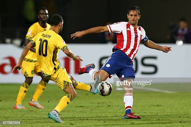 Roque Santa Cruz of Paraguay fights for the ball with Jobi McAnuff of Jamaica during the 2015 Copa America Chile Group B match between Paraguay and...