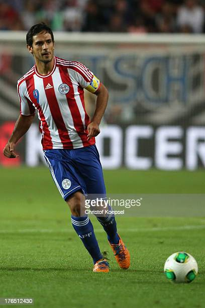 Roque Santa Cruz of Paraguay runs with the ball during the international friendly match between Germany and Paraguay at FritzWalterStadium on August...