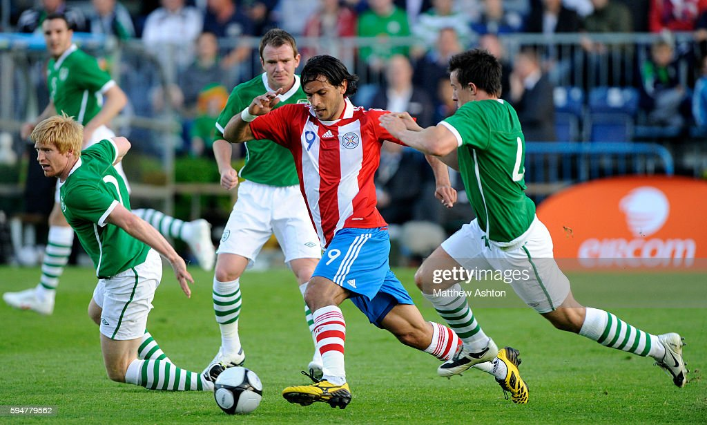 Roque Santa Cruz of Paraguay takes on Sean St Ledger of Republic of Ireland and Paul McShane of Republic of Ireland