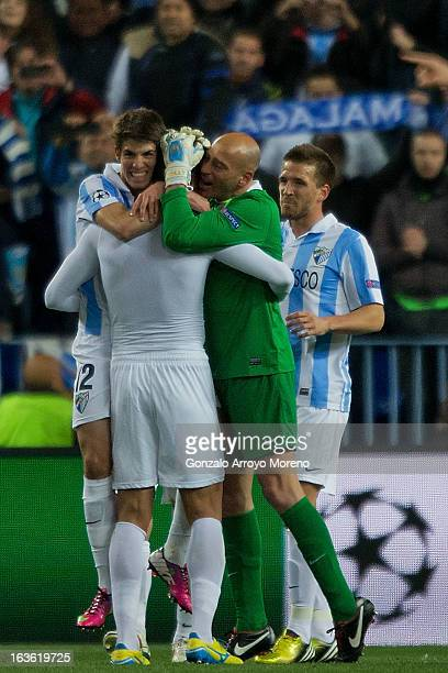 Roque Santacruz of Malaga CF celebrates winning the match with teammates Lucas Piazon goalkeeper Willy Caballero and Ignacio Camacho during the UEFA...