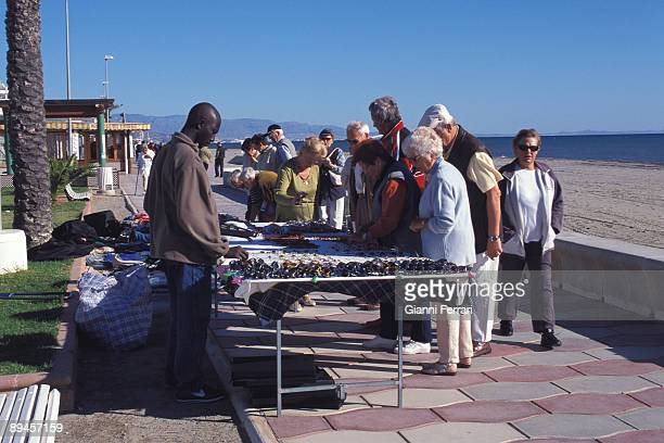 Roquetas de Mar Holydays and turism of elderly people Watching stalls in the promenade