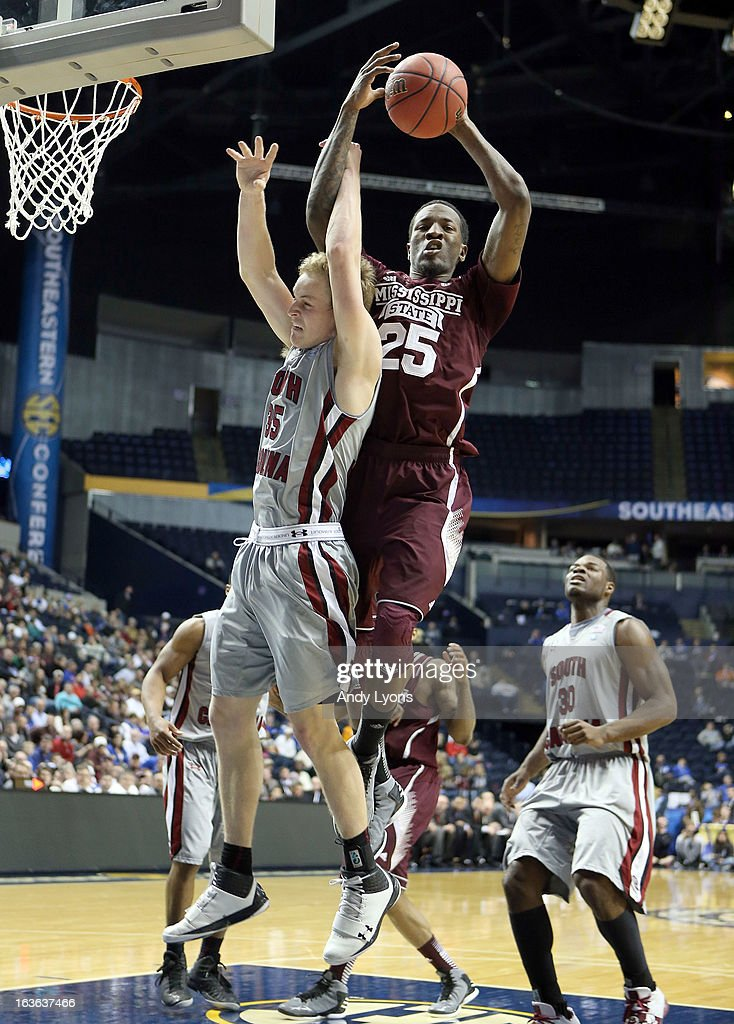 Roquez Johnson #25 of the Mississippi State Bulldogs grabs a rebound against the South Carolina Gamecocks during the first round game of the Southeastern Conference Tournament at Bridgestone Arena on March 13, 2013 in Nashville, Tennessee.