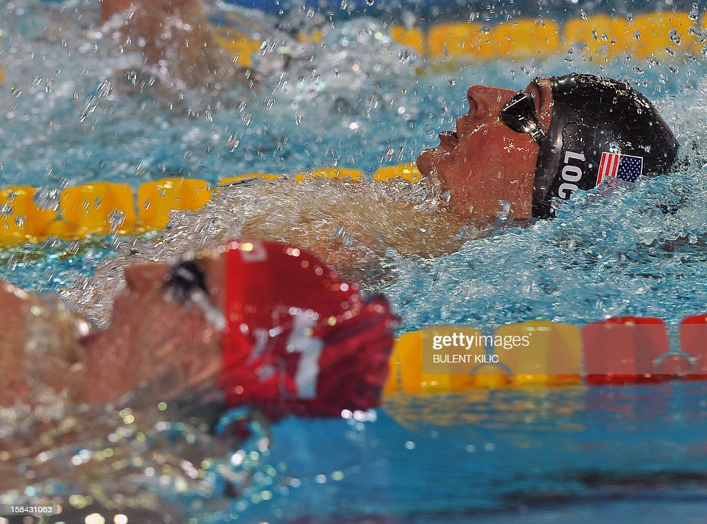 Roroslaw Kawecki (L) of Poland competes with Ryhan Lochte of the US in the 200m backstroke final during the Short Course Swimming World Championships in Istanbul on December 16, 2012. Kawecki won the race.