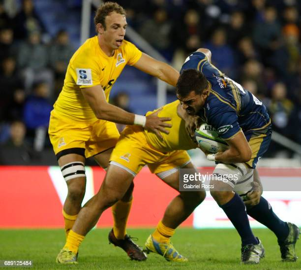 Rory Arnold of Brumbies is tackled by Agustin Creevy and Leonardo Senatore of Jaguares during a match between Jaguares and Brumbies as part of Super...