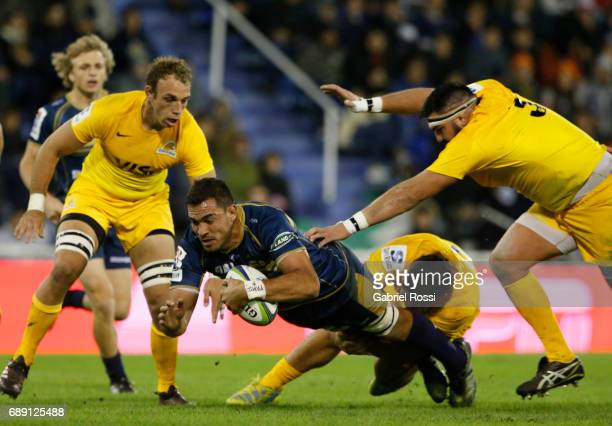 Rory Arnold of Brumbies is tackled by Agustin Creevy of Jaguares during a match between Jaguares and Brumbies as part of Super Rugby Rd 14 at Jose...