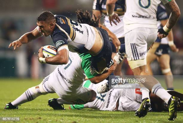 Rory Arnold of the Brumbies is tackled during the round five Super Rugby match between the Brumbies and the Highlanders at GIO Stadium on March 25...