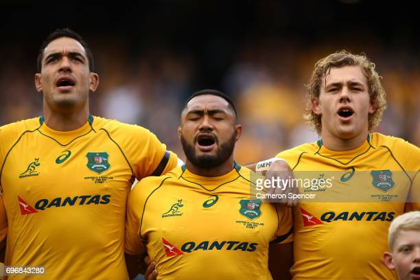 Rory Arnold Sekope Kepu and Ned Hanigan of the Wallabies sing the Australian national anthem during the International Test match between the...