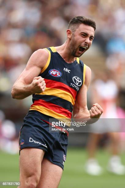 Rory Atkins of the Crows celebrates after kicking a goal during the round one AFL match between the Adelaide Crows and the GWS Giants at Adelaide...