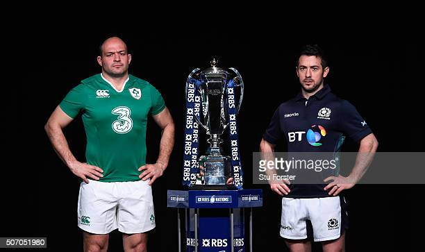 Rory Best captain of Ireland and Greig Laidlaw captain of Scotland pose with the trophy during the RBS Six Nations launch at The Hurlingham Club on...