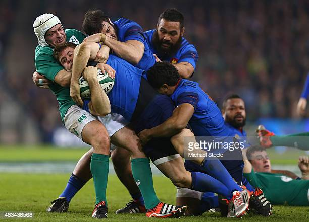 Rory Best of Ireland holds onto Rory Kockott of France as Yoann Maestri Uini Atonio and Wesley Fofana join forces during the RBS Six Nations match...