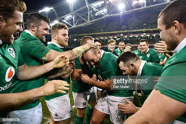 Rory Best of Ireland is congratulated on his 100th cap by his team mates following the international match between Ireland and Australia at the Aviva...