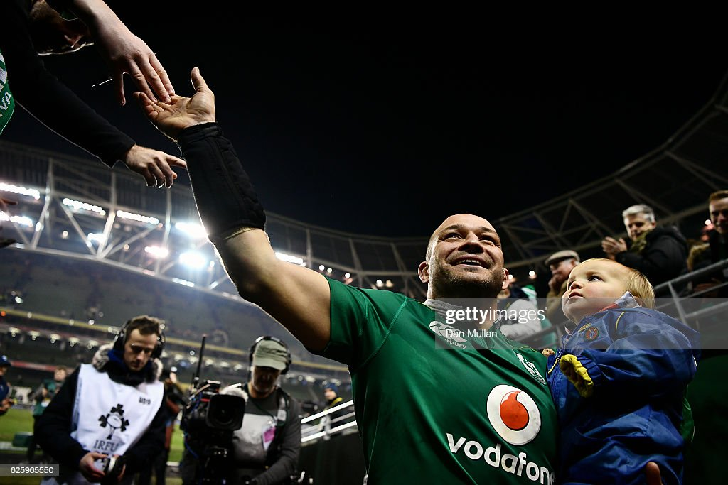 Rory Best of Ireland leaves the field with his son Richie following his 100th cap and his side's victory during the international match between Ireland and Australia at the Aviva Stadium on November 26, 2016 in Dublin, Ireland.