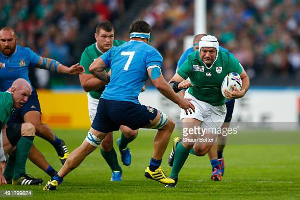 Rory Best of Ireland runs at Simone Favaro of Italy during the 2015 Rugby World Cup Pool D match between Ireland and Italy at the Olympic Stadium on...