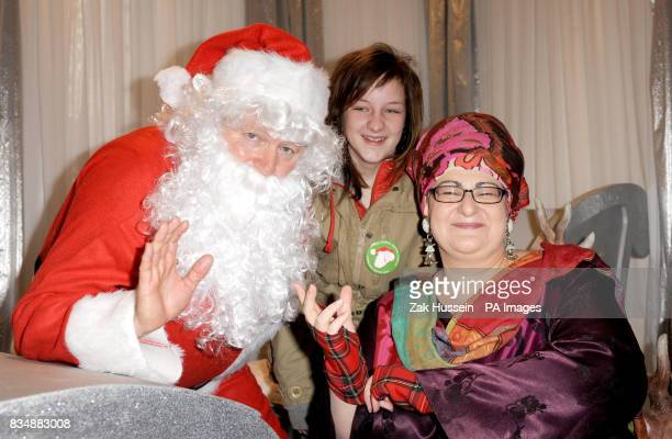 Rory Bremner as Santa Claus Lauren Walton and Camila Batmanghelidjh from the Kids Company charity at The General Trading Company in Sloane Square...
