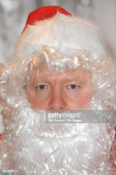 Rory Bremner impersonates Santa Claus for the day to raise funds for the Kids Company charity at The General Trading Company in Sloane Square south...