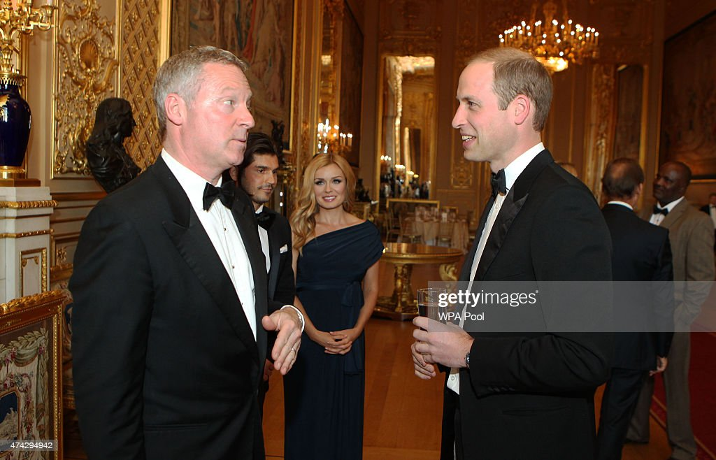 Rory Bremner talks to Prince William, Duke of Cambridge during a reception and dinner to mark the African conservation charity Tusk Trust's 25th anniversary on May 21, 2015 at Windsor Castle, Windsor, England.