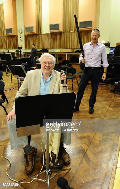 Rory Bremner with a rifle and Sir David Attenborough with a floor polisher during a rehearsal for Sir Malcolm Arnold's 'A Grand Grand Overture' which...