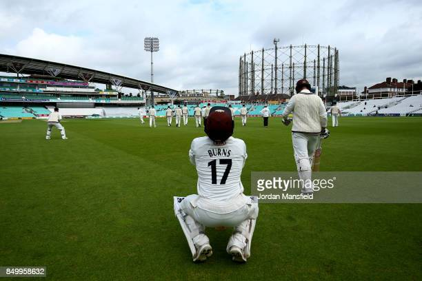 Rory Burns and Mark Stoneman of Surrey make their way out to open the batting during day two of the Specsavers County Championship Division One match...