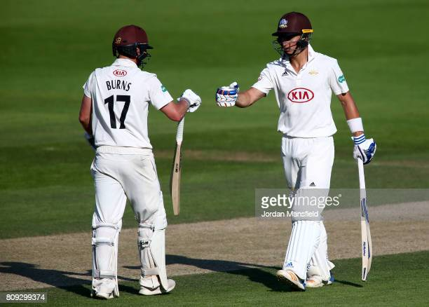 Rory Burns and Tom Curran of Surrey come together on the wicket during day three of the Specsavers County Championship Division One match between...