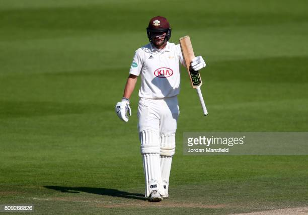 Rory Burns of Surrey celebrates his 150 during day three of the Specsavers County Championship Division One match between Surrey and Hampshire at The...