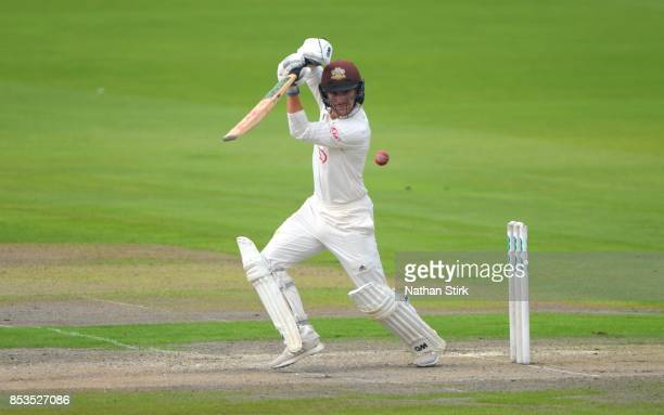 Rory Burns of Surrey drives the ball while batting during the County Championship Division One match between Lancashire and Surrey at Old Trafford on...