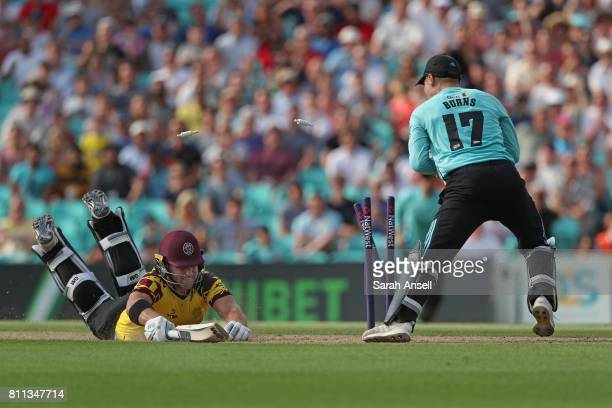 Rory Burns of Surrey runs out Corey Anderson of Somerset for 81 runs during the NatWest T20 Blast match at The Kia Oval on July 9 2017 in London...