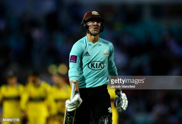 Rory Burns of Surrey walks off the field after being caught out by Graeme van Buuren of Gloucestershire during the NatWest T20 Blast match between...