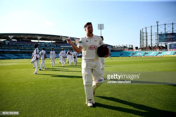 Rory Burns of Surrey walks off the field at the end of play on day three of the Specsavers County Championship Division One match between Surrey and...