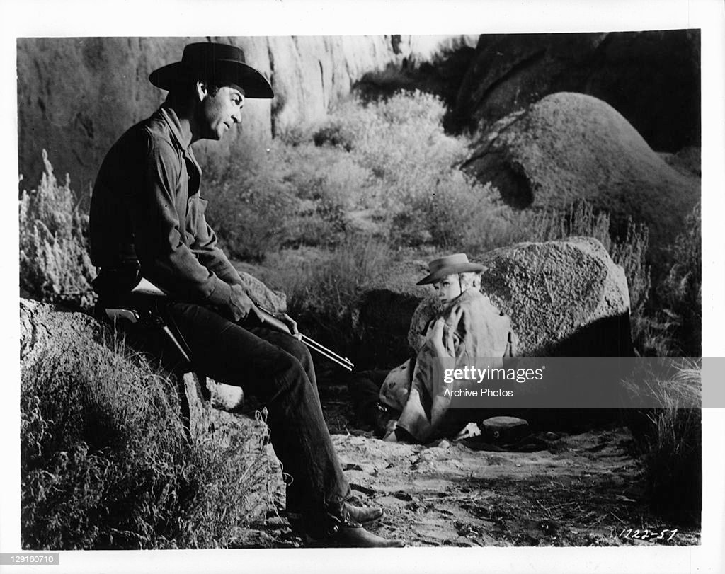Rory Calhoun And Anne Francis in a scene from the film 'The Hired Gun' 1957