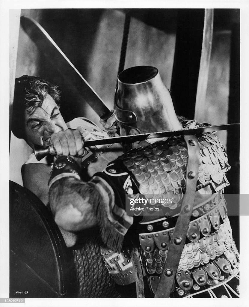Rory Calhoun fights off a soldier in a scene from the film 'The Colussus Of Rhodes' 1961