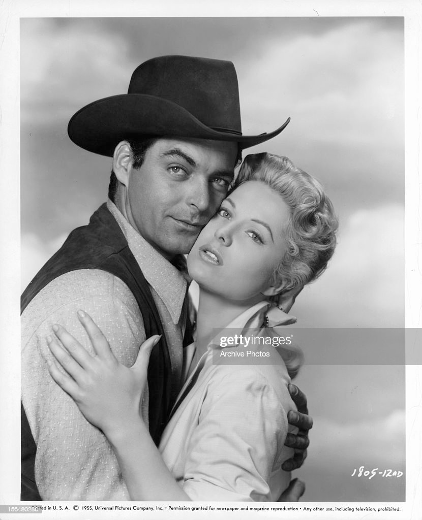 Rory Calhoun holding Martha Hyer in publicity portrait for the film 'Red Sundown' 1956