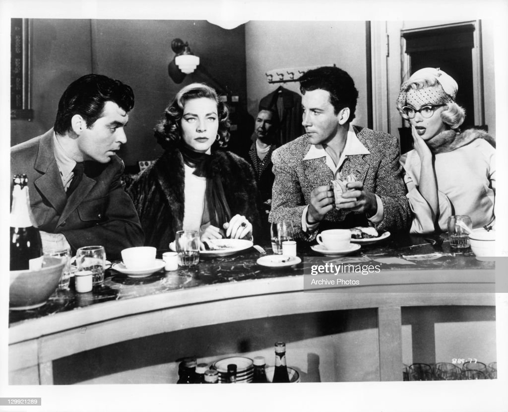 Rory Calhoun Lauren Bacall Cameron Mitchell and Marilyn Monroe sitting in diner in a scene from the film 'How To Marry A Millionaire' 1953