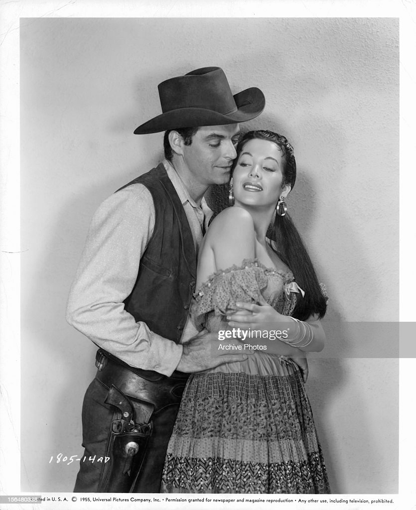 Rory Calhoun leaning up on Lita Baron in publicity portrait for the film 'Red Sundown' 1956