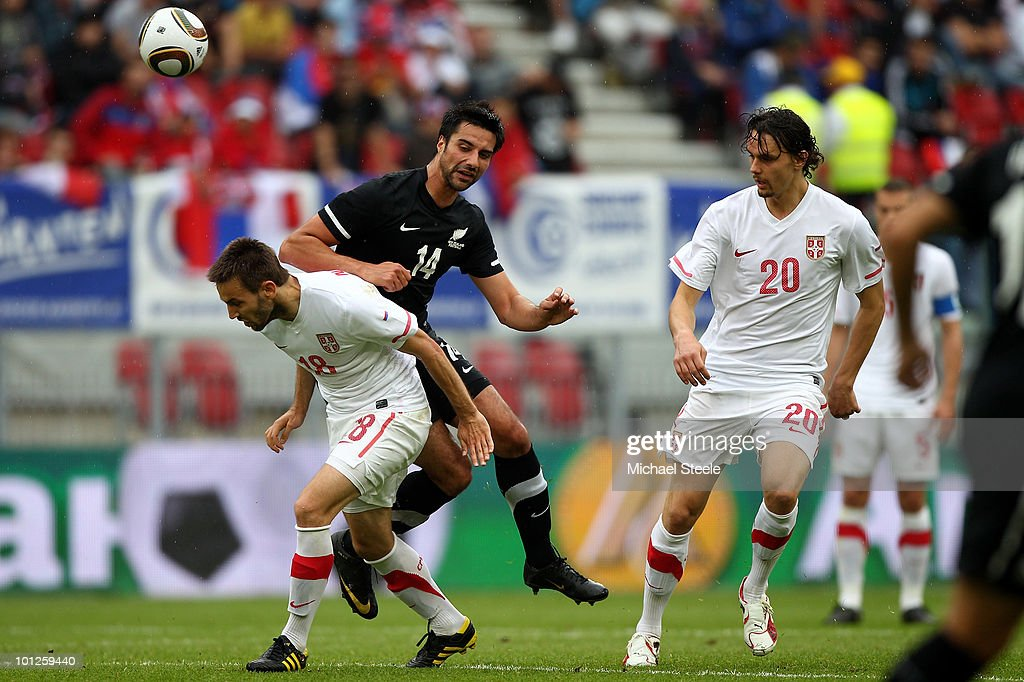 Rory Fallon (c) of New Zealand feels the force of a challenge from Milos Ninkovic (l) during the New Zealand v Serbia International Friendly match at the Hypo Group Arena on May 29, 2010 in Klagenfurt, Austria.