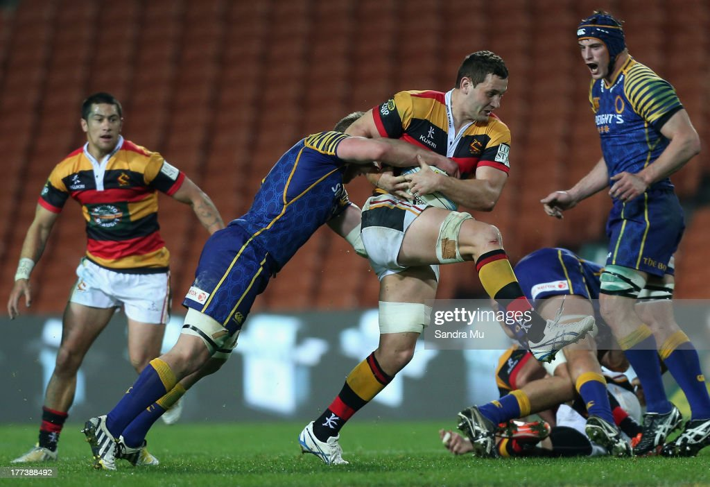 Rory Grice of Waikato is tackled by Gareth Evans of Otago during the round two ITM Cup Ranfurly Shield match between Waikato and Otago at Waikato...