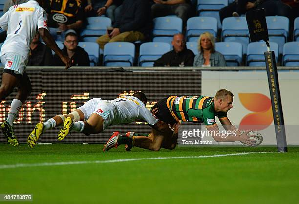 Rory Hutchinson of Northampton Saints scores a try during the Singha Premiership Rugby 7s Series Coventry at Ricoh Arena on August 21 2015 in...