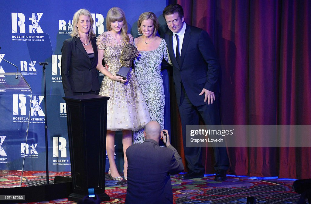 Rory Kennedy, Taylor Swift, Kerry Kennedy, and Alec Baldwin pose onstage at the 2012 Ripple Of Hope Gala at The New York Marriott Marquis on December 3, 2012 in New York City.
