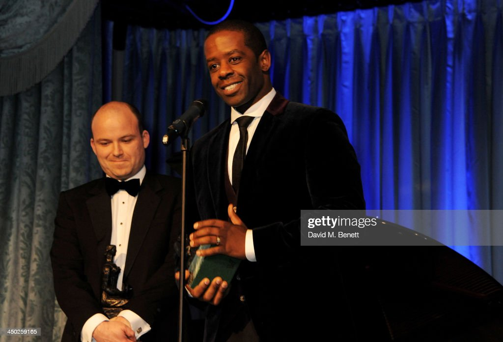 Rory Kinnear (L) and <a gi-track='captionPersonalityLinkClicked' href=/galleries/search?phrase=Adrian+Lester&family=editorial&specificpeople=215408 ng-click='$event.stopPropagation()'>Adrian Lester</a> jointly accept the Best Actor award attends the 59th London Evening Standard Theatre Awards at The Savoy Hotel on November 17, 2013 in London, England.
