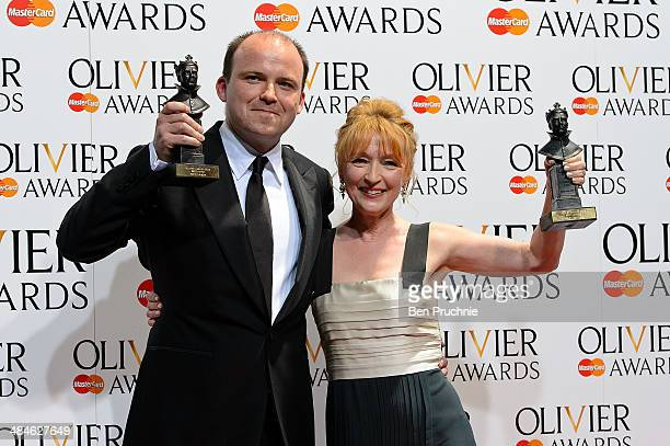 Rory Kinnear and Lesley Manville pose in the press room at the Laurence Olivier Awards at The Royal Opera House on April 13 2014 in London England