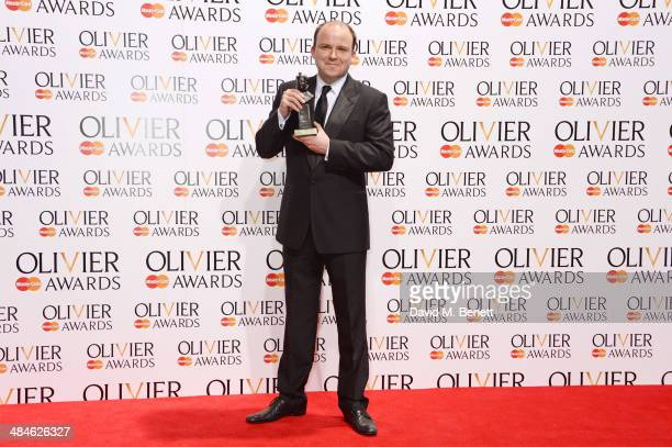 Rory Kinnear winner of Best Actor for 'Othello' poses in the press room at the Laurence Olivier Awards at The Royal Opera House on April 13 2014 in...